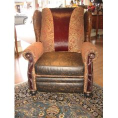Unique Furniture, recliner with tooled leather burgundy hair on hide