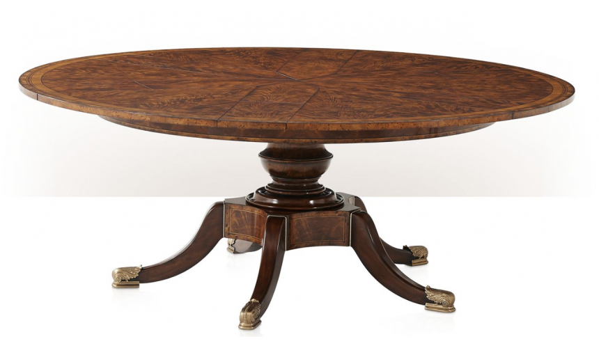 Dining Tables Circular extending mahogany dining table.