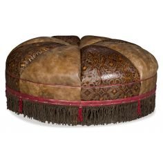 Round leather ottoman with embossed leather and fringed detail