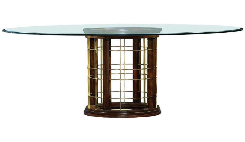 Dining Tables Glass topped dinning table with pedestal base.