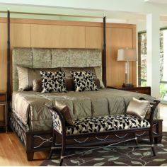 Bed with tufted headboard and animal print accent pillows