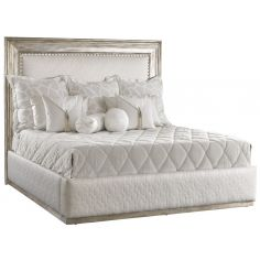 Bed with quilted platinum headboard with distressed wooden detailing