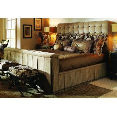 Bed with tufted headboard and rolled footboard with intricately pleated fabric