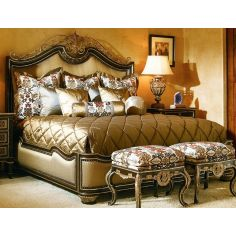French style bed with intricately scrolled headboard