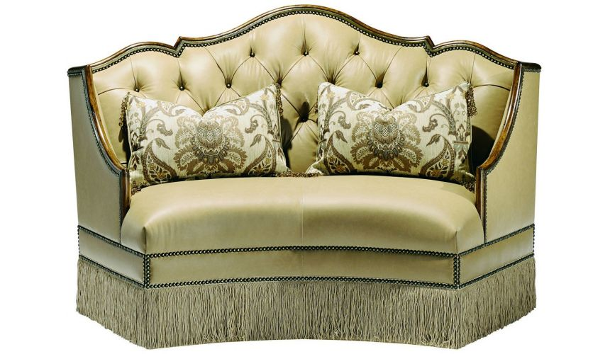 SETTEES, CHAISE, BENCHES Leather settee with wood trim and chic fringed skirt
