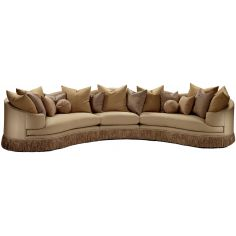Cream colored sofa with luxurious fabric and fringed skirt