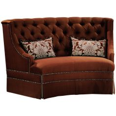Chocolate colored settee withtufted back and nailhead trim