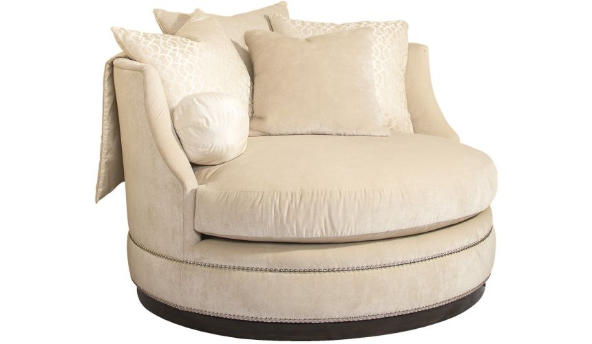 SETTEES, CHAISE, BENCHES Ivory rounded barrel style chair with nailhead trim