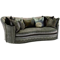 Dove grey sofa with elegant curved back and intricate trim