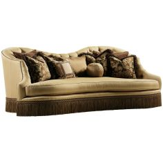 Bisque colored sofa with beautiful curved lines and fringed skirt