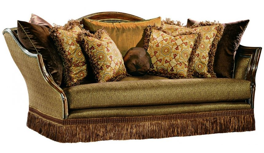 SOFA, COUCH & LOVESEAT Sofa covered in warm earth toned fabrics with hand carved wooden accents