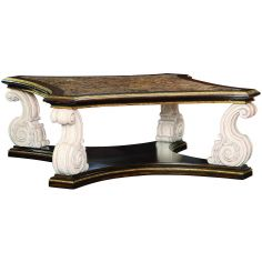 Cocktail table with intricately carved scrolled legs
