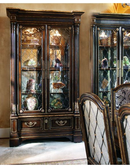 Breakfronts & China Cabinets Old world display case with glass doors adorned with metal lattice detail