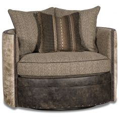 Barrel style chair covered in leather, herringbone, and animal print