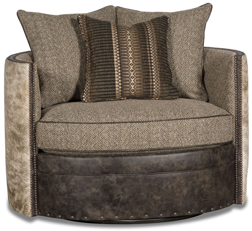 Barrel style chair covered in leather, herringbone, and ...
