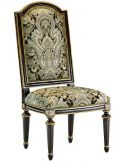 Dining room chair with rich printed fabric and carved wooden legs
