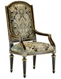 Dining room chair with arms covered in printed fabric with carved wooden legs