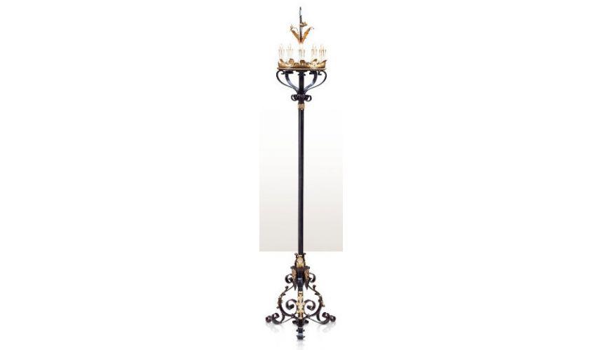 A wrought iron five light floor candelabrum