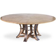 Large round table with self storing leaves.