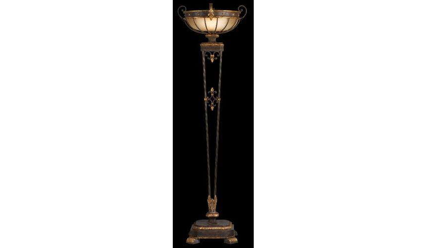 Lighting Torchiere of antiqued iron and gold leaf finish