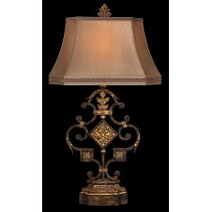 Elegant iron table lamp in antiqued iron and warm gold leaf finish