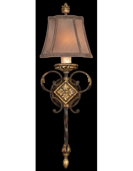 Lighting Wall sconce in antiqued finish. Features hand sewn silk shade with braided trim.