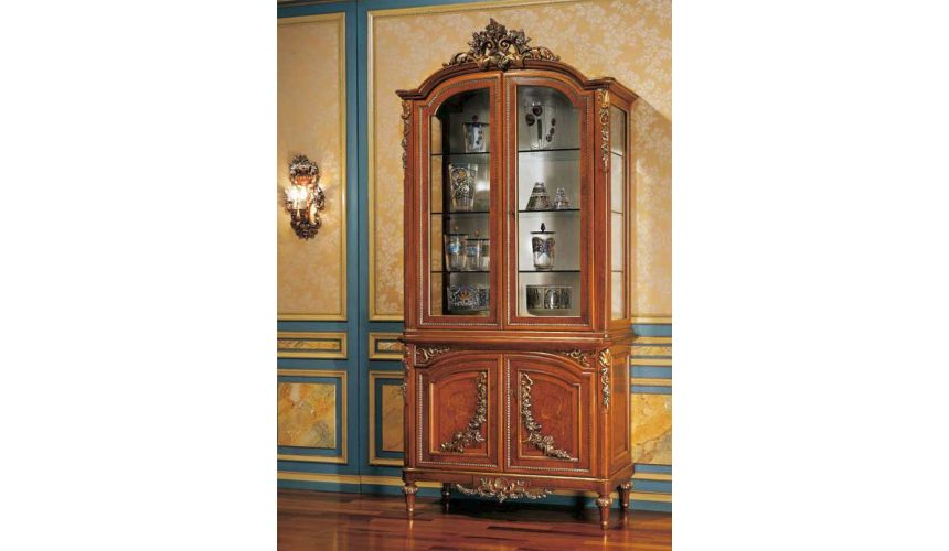 Breakfronts & China Cabinets Striking Showcase Cabinet from our European hand painted furniture collection. 7102