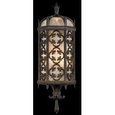 Wall sconce in stylized quatrefoil design features Marbella wrought iron