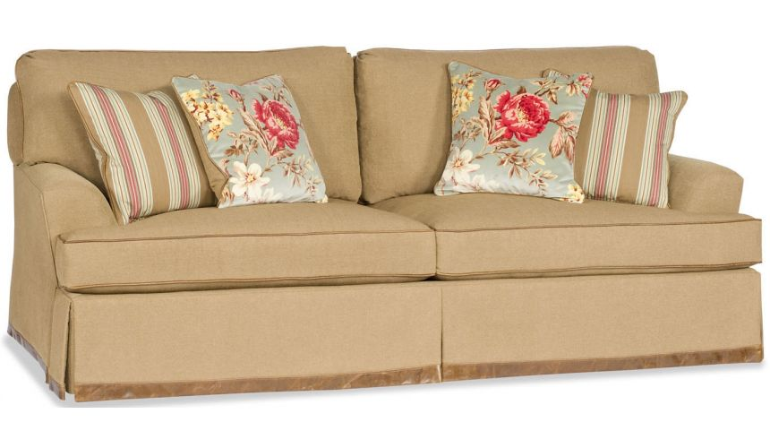 SOFA, COUCH & LOVESEAT Tan Sofa with Floral pillow