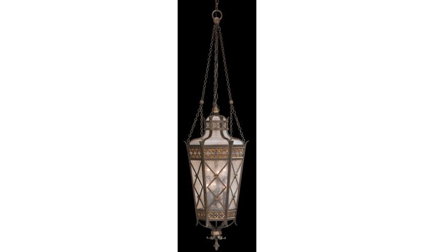 Lighting Large lantern of solid brass featuring a variegated rich umber patina