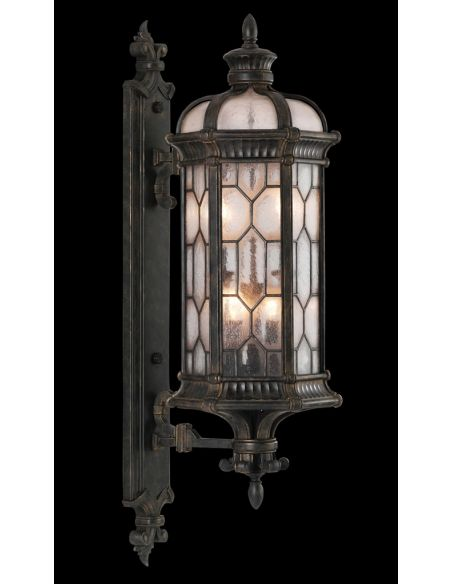 Lighting Small wall mount of antiqued bronze finish with subtle gold accents