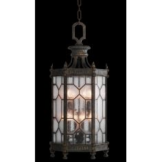 Large lantern in antiqued bronze finish with subtle gold accents
