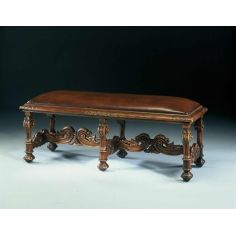 Carved oak bench or window seat. Fine home furnishings.