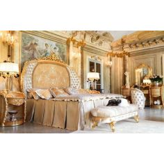 Hand-made carvings make this bedroom plush and royal