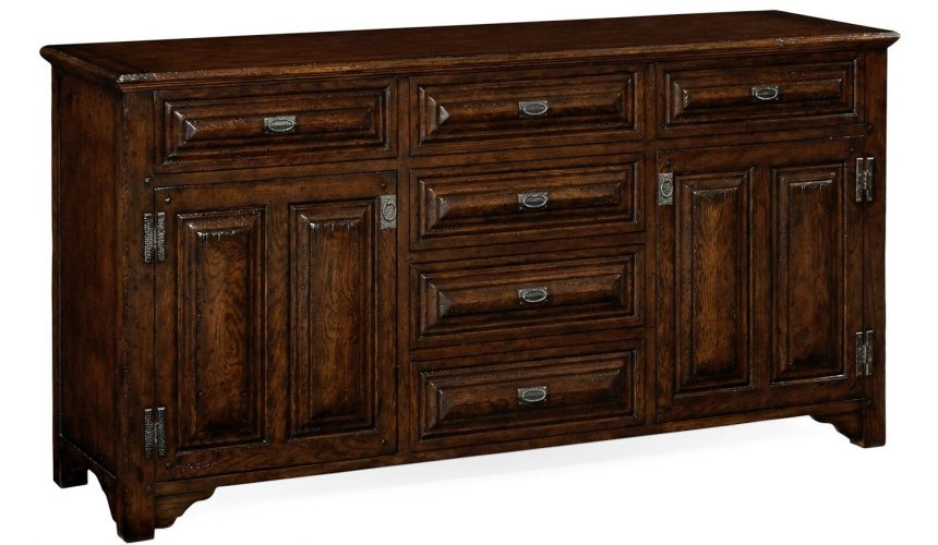 Breakfronts & China Cabinets English Tudor style dark oak cabinet or dresser