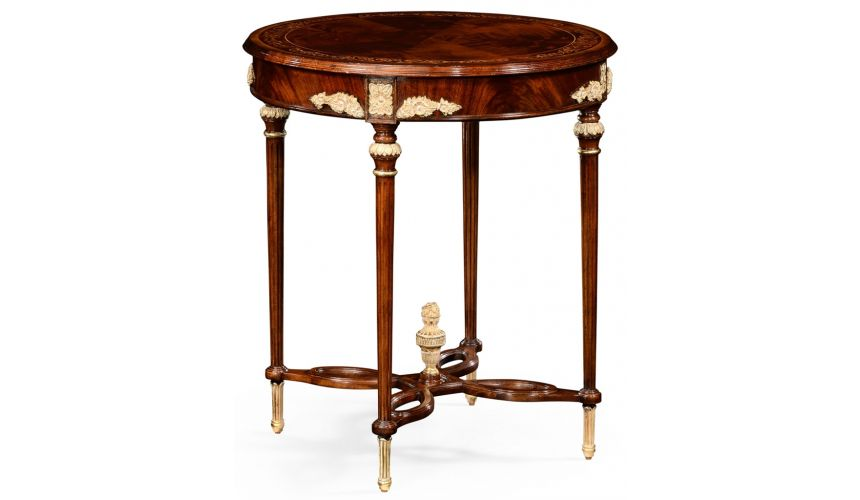 Round & Oval Side Tables Mahogany round table with gilded accents