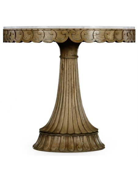 Foyer and Center Tables Carved oak table with marble top.