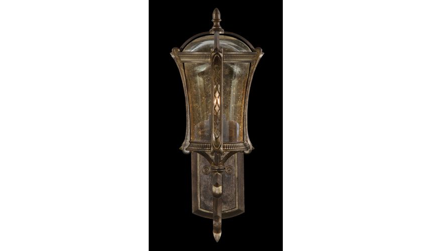 Lighting Petite wall mount in an aged antique gold finish