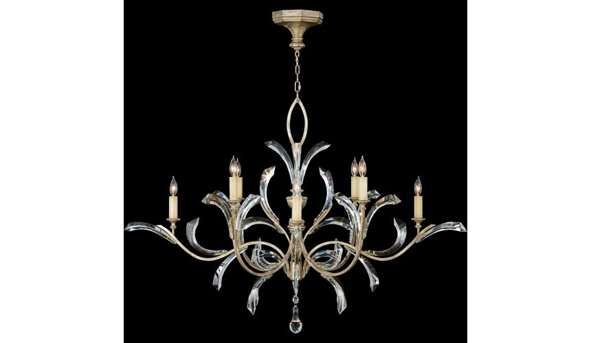 Lighting Chandelier in warm muted silver leaf finish. Features beveled crystal accents