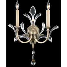 Sconce in warm muted silver leaf finish. Features beveled crystal accents