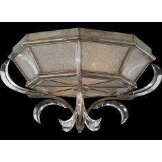 Flush mount in warm muted silver leaf finish. Features beveled crystal accents