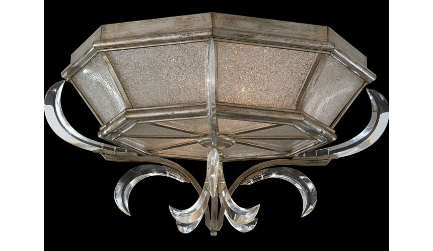 Lighting Flush mount in warm muted silver leaf finish. Features beveled crystal accents
