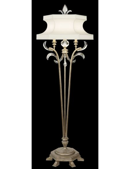 Lighting Floor lamp in warm muted silver leaf finish. Features laminated silk shantung shade