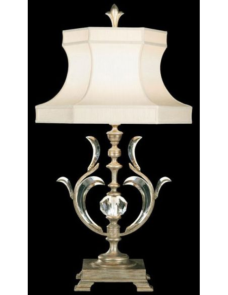 Lighting Table lamp in warm muted silver leaf finish. Features laminated silk shantung shade