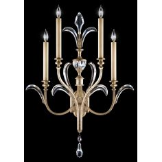 Sconce in a warm muted silver leaf finish featuring beveled crystal accents