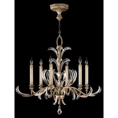 Chandelier in a warm muted silver leaf finish featuring beveled crystal accents