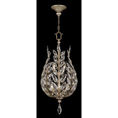 Lantern in antiqued warm silver leaf with stylized faceted crystal leaves