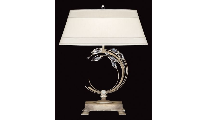 Lighting Left-side facing table lamp in antiqued warm silver leaf with stylized faceted crystal leaves