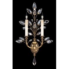 Sconce in gold leaf with stylized faceted crystal leaves
