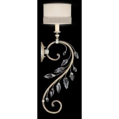 Sconce in antiqued warm silver leaf with stylized faceted crystal leaves